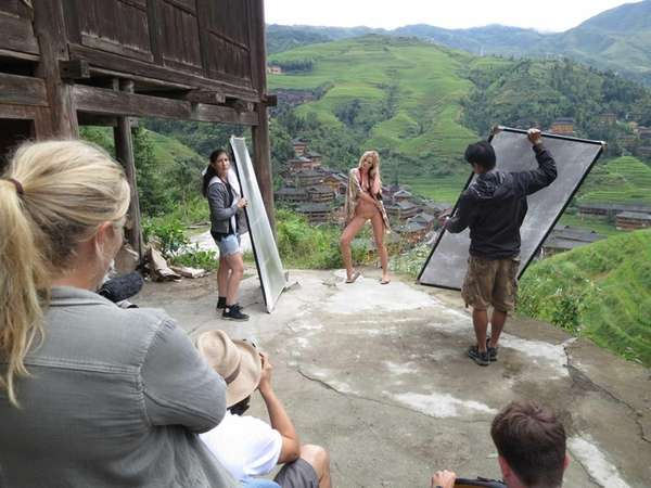 A model being photographed on location in Guilin,