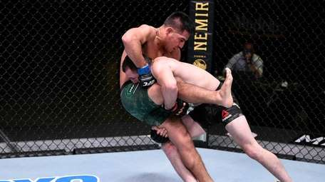 (R-L) Merab Dvalishvili takes down Gustavo Lopez in