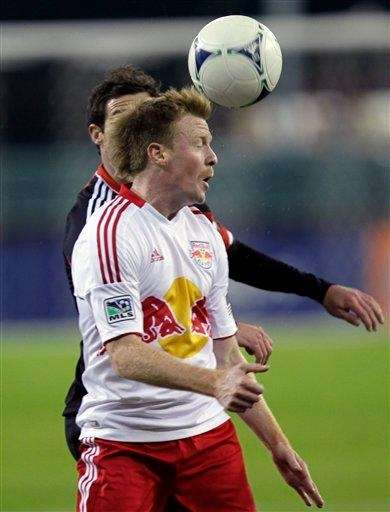 The New York Red Bulls' Dax McCarty, foreground,