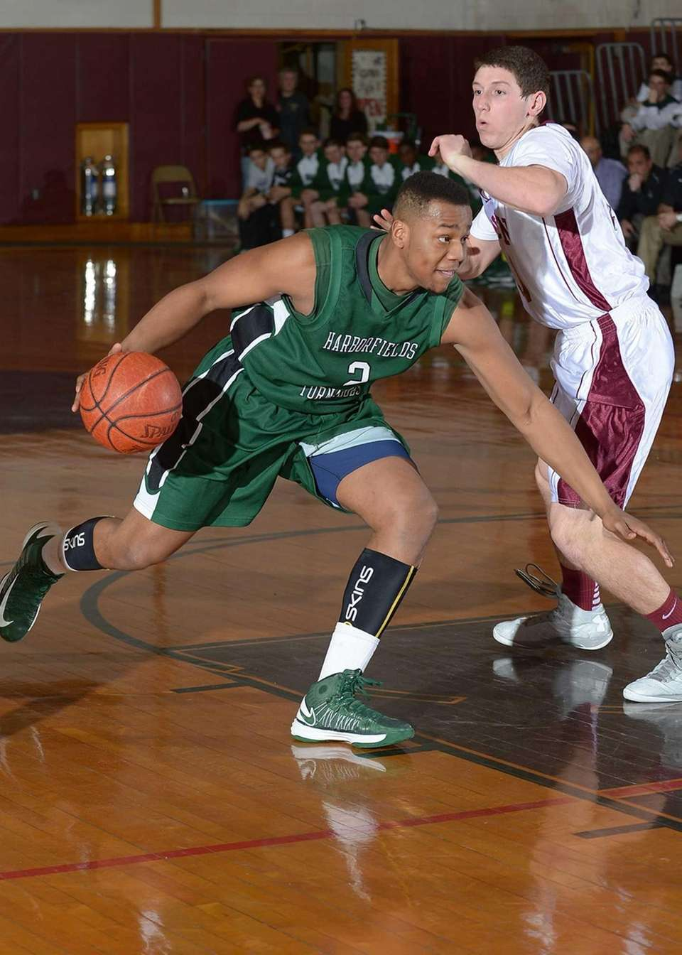 Harborfields' Jon Patron, left, drives to the basket