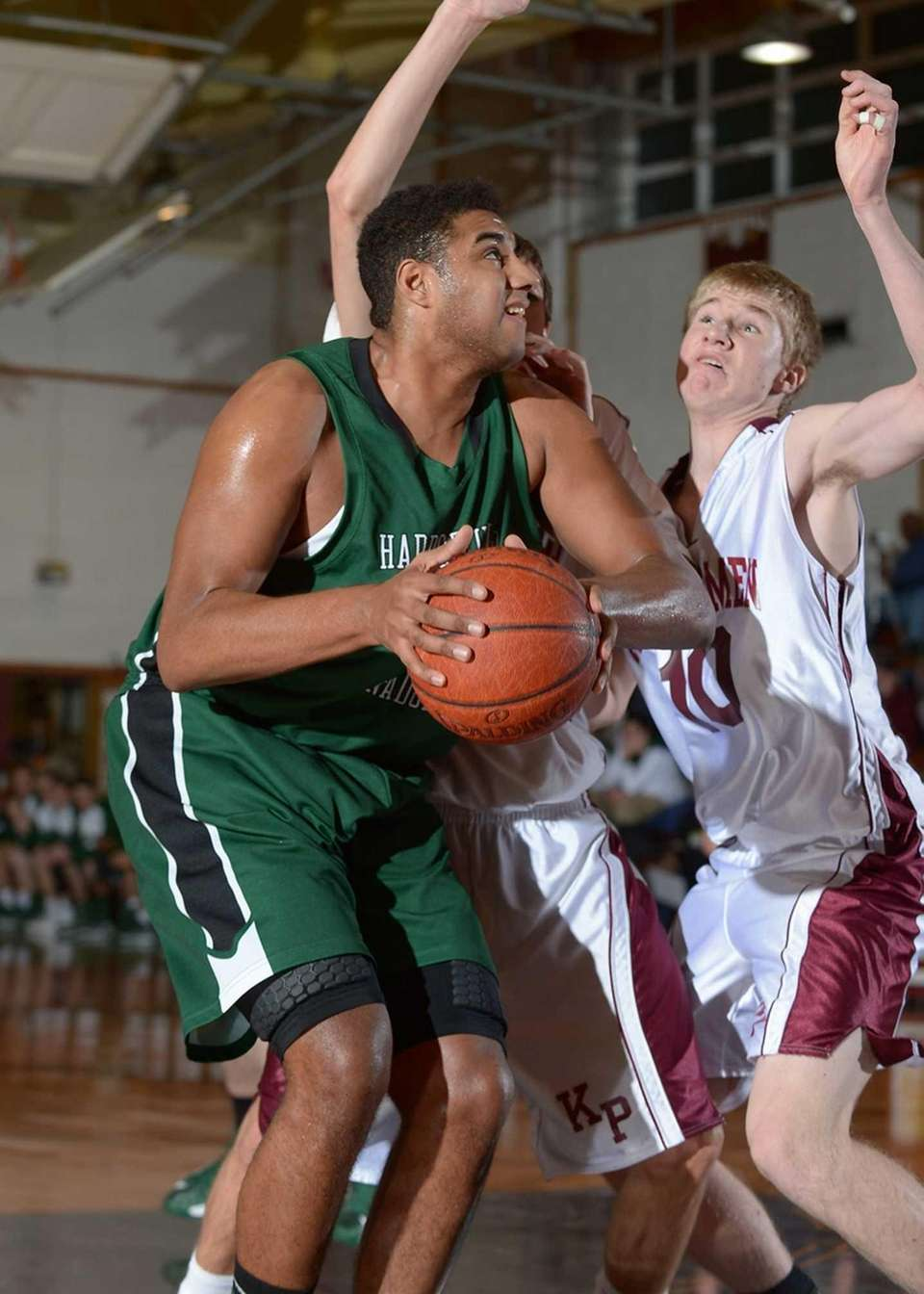 Harborfields' Chris Brady (43) goes up for the