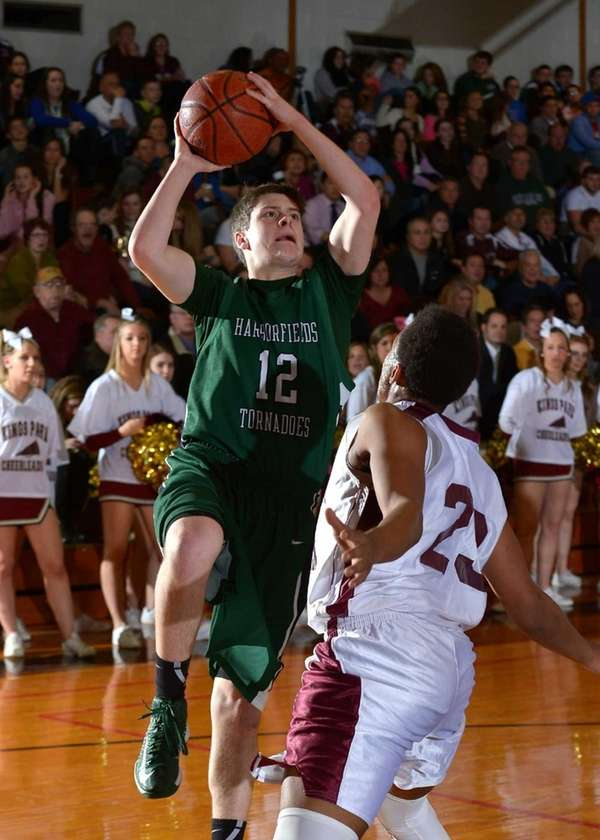 Harborfields' Thomas Zazzarino (12) goes up for a