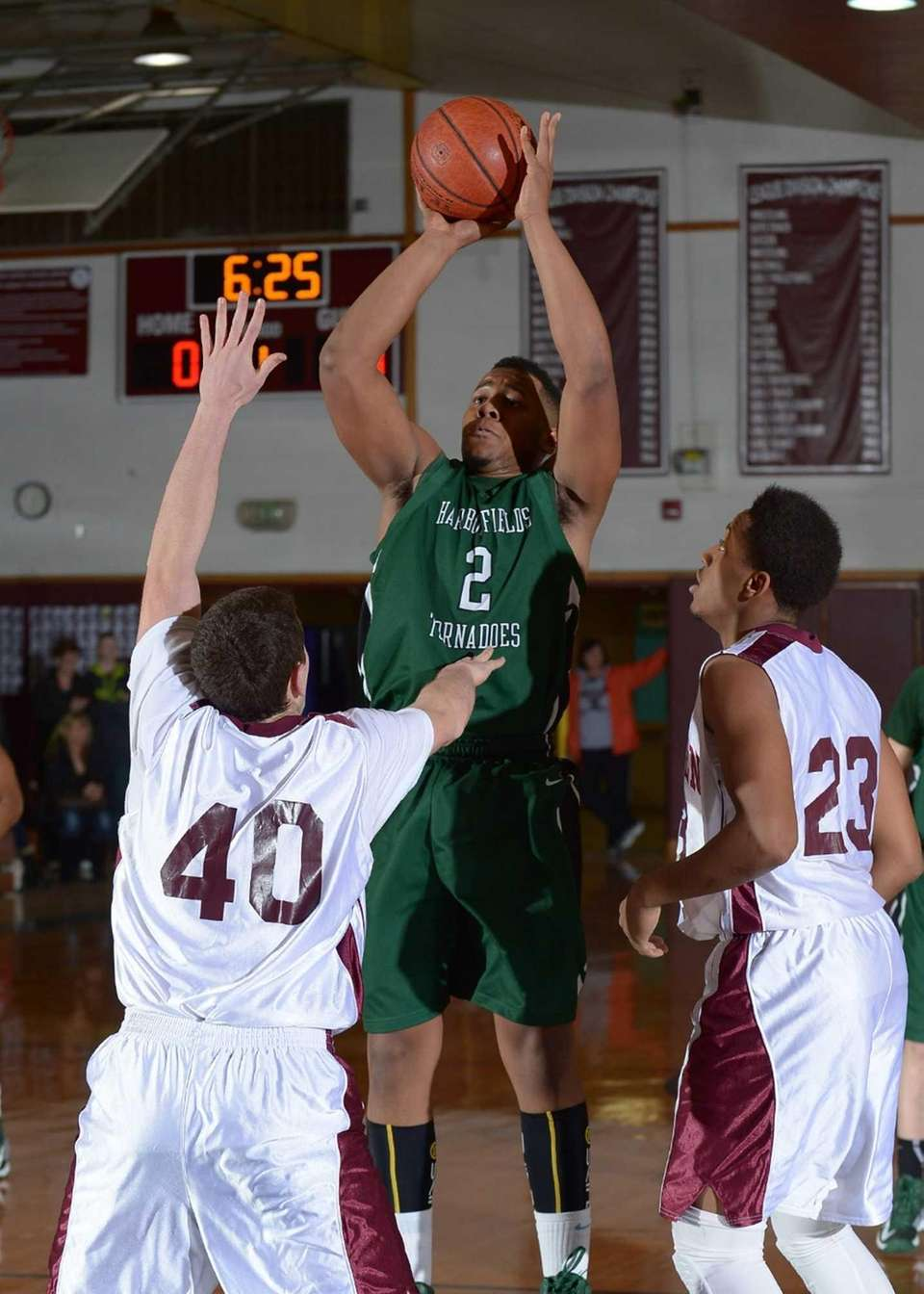 Harborfields' Jon Patron (2) goes up for the