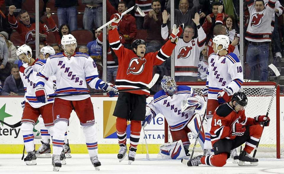 The New Jersey Devils' Adam Henrique (14) celebrates