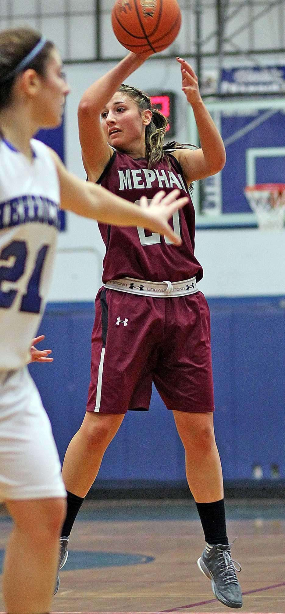 Mepham's Nicole Castaldo delivers a no-look pass during