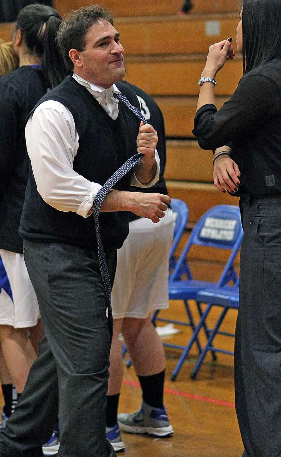 Herricks coach G. Davis Lavey walks off the