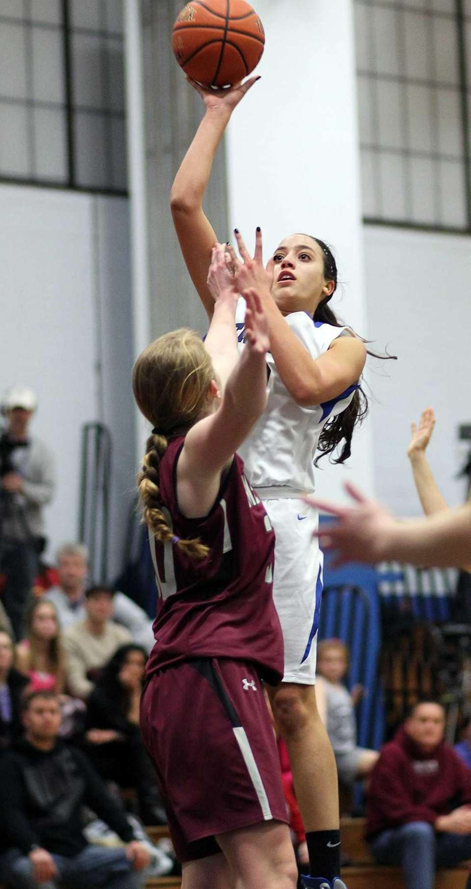 Herricks' Alison Ricchiuti puts up a shot during