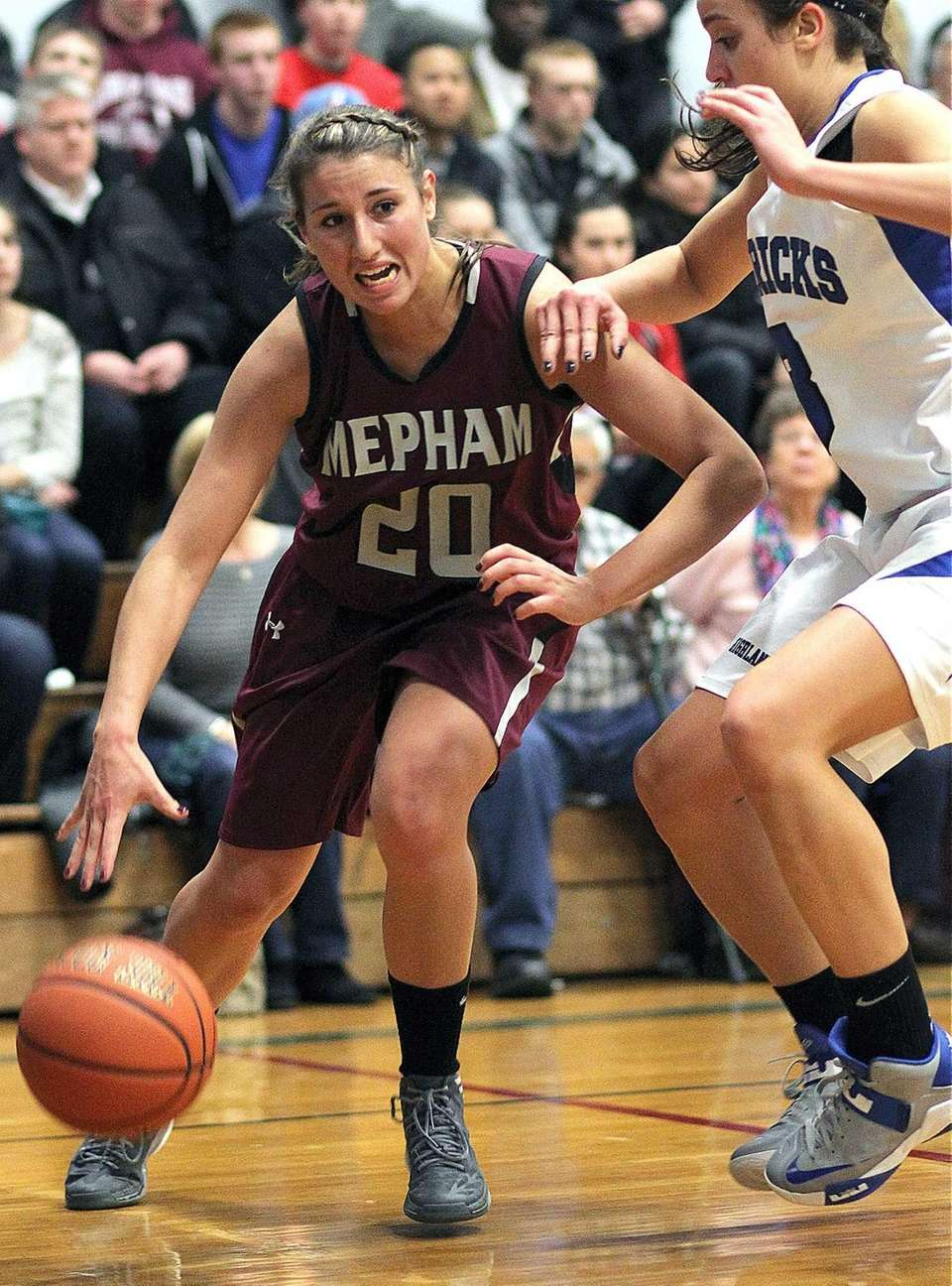 Mepham's Nicole Castaldo charges under the boards during