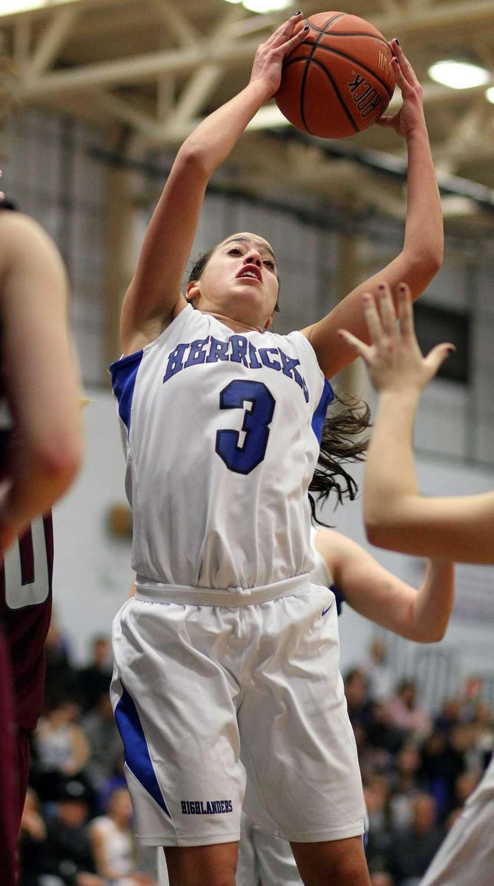Herricks' Alison Ricchiuti grabs a rebound during a