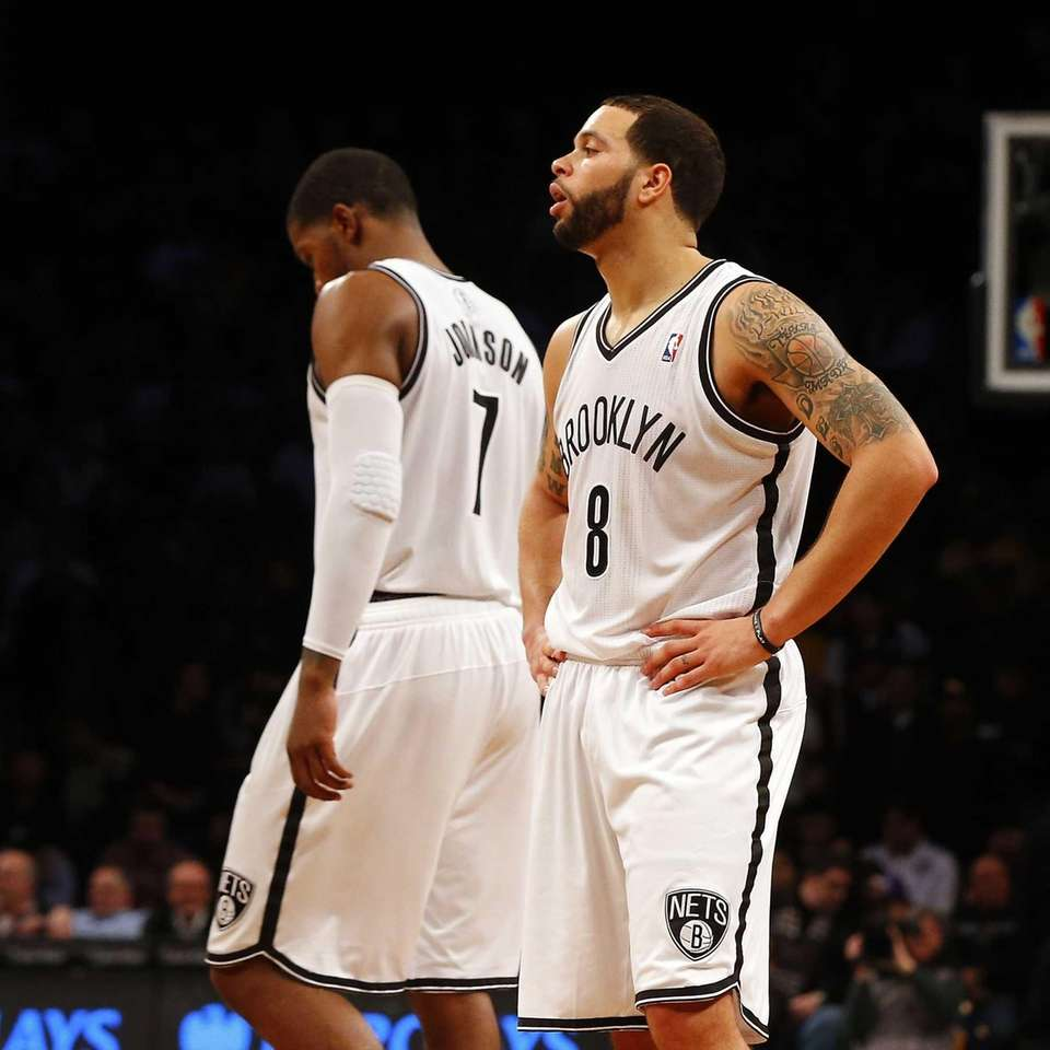 Deron Williams and Joe Johnson look on late