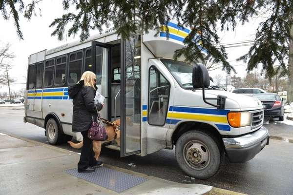Marilyn Tucci, 61, of Shirley, boards a bus