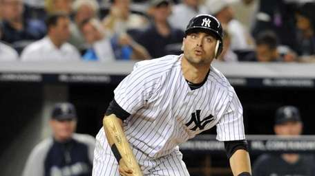 Francisco Cervelli watches the flight of the ball