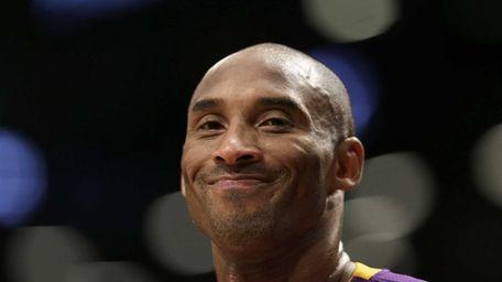 Los Angeles Lakers guard Kobe Bryant smiles during