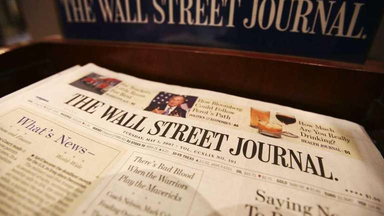 Copies of The Wall Street Journal sit on