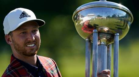 Daniel Berger poses with the championship trophy after