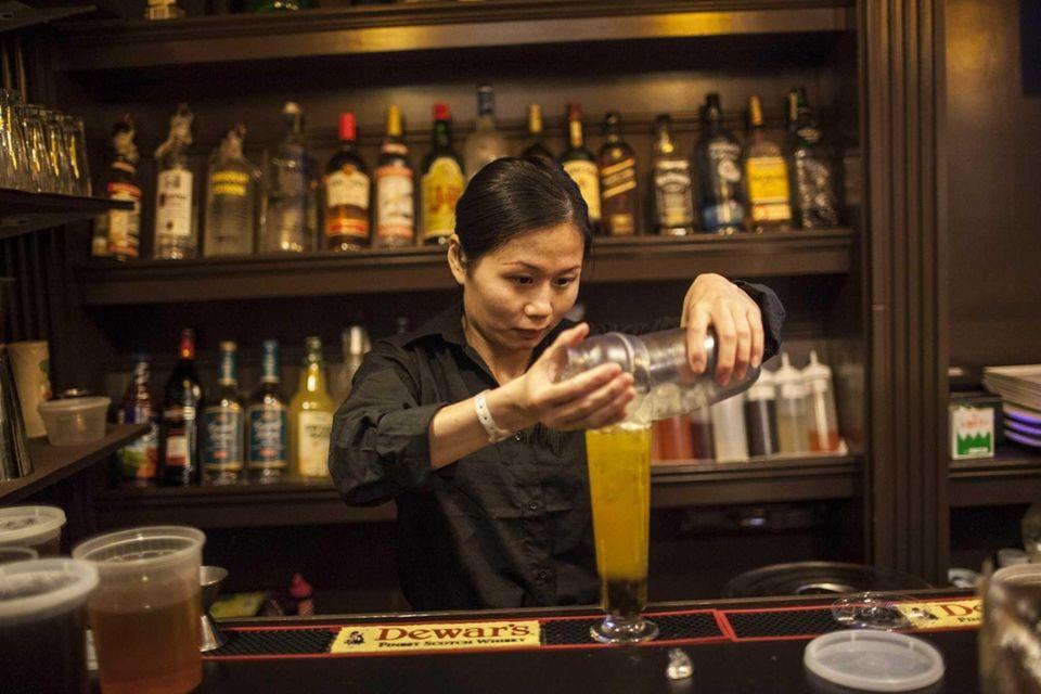 Susan Gao mixes a fresh bubble tea at