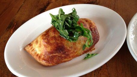 Empanada with pork and ginger at Salumi in