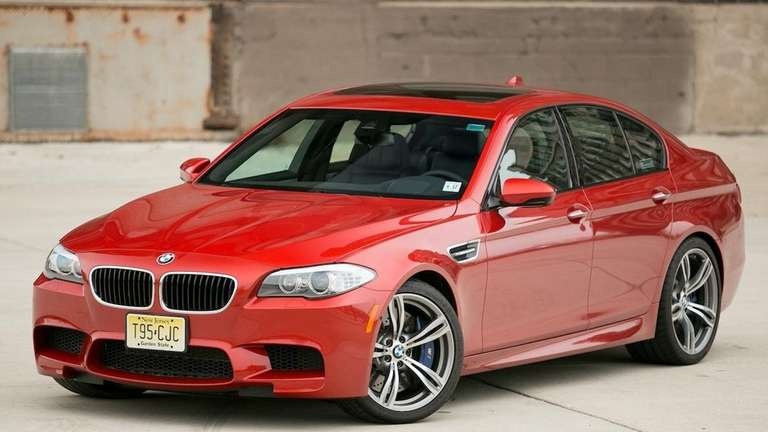 The 2013 BMW M5 pairs four doors with