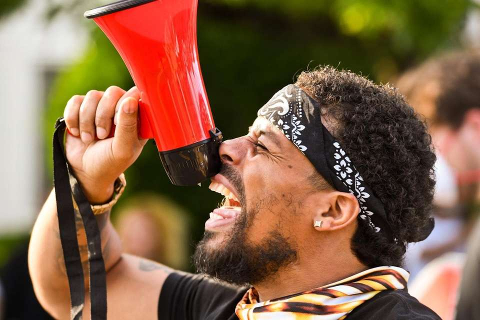 A crowd protests police brutality in the wake
