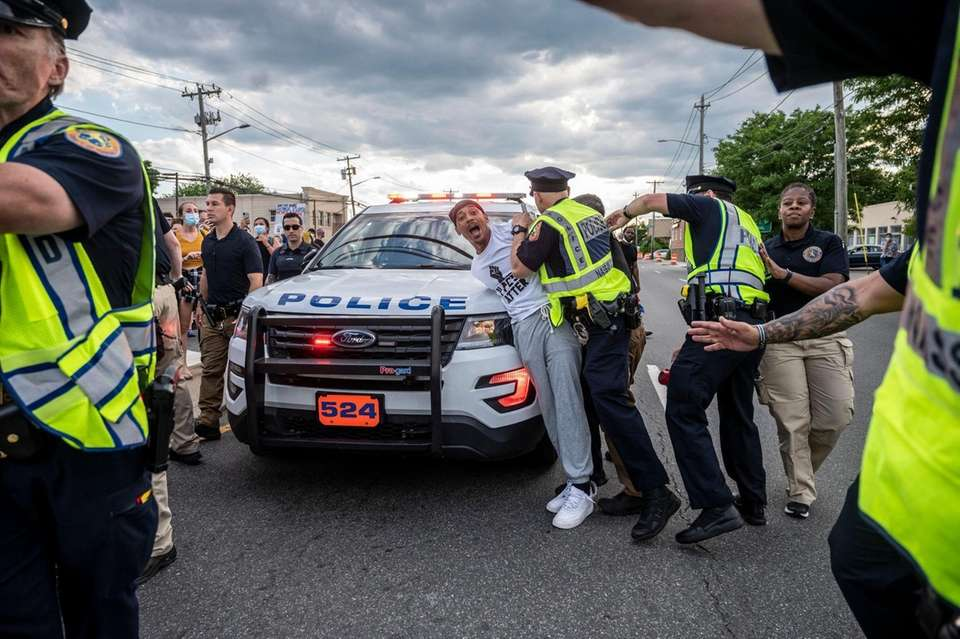 Protestors and police clash during a pro Black