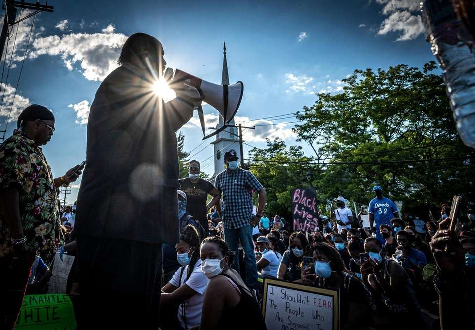Rev. Arthur Mackey Jr. walking with protesters from