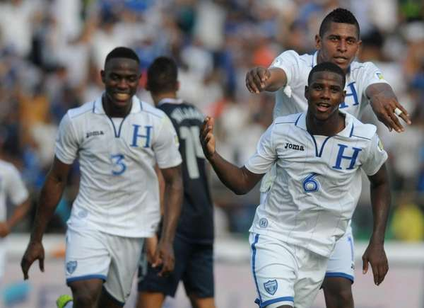 Honduras' Juan Carlos Garcia, front, celebrates followed by