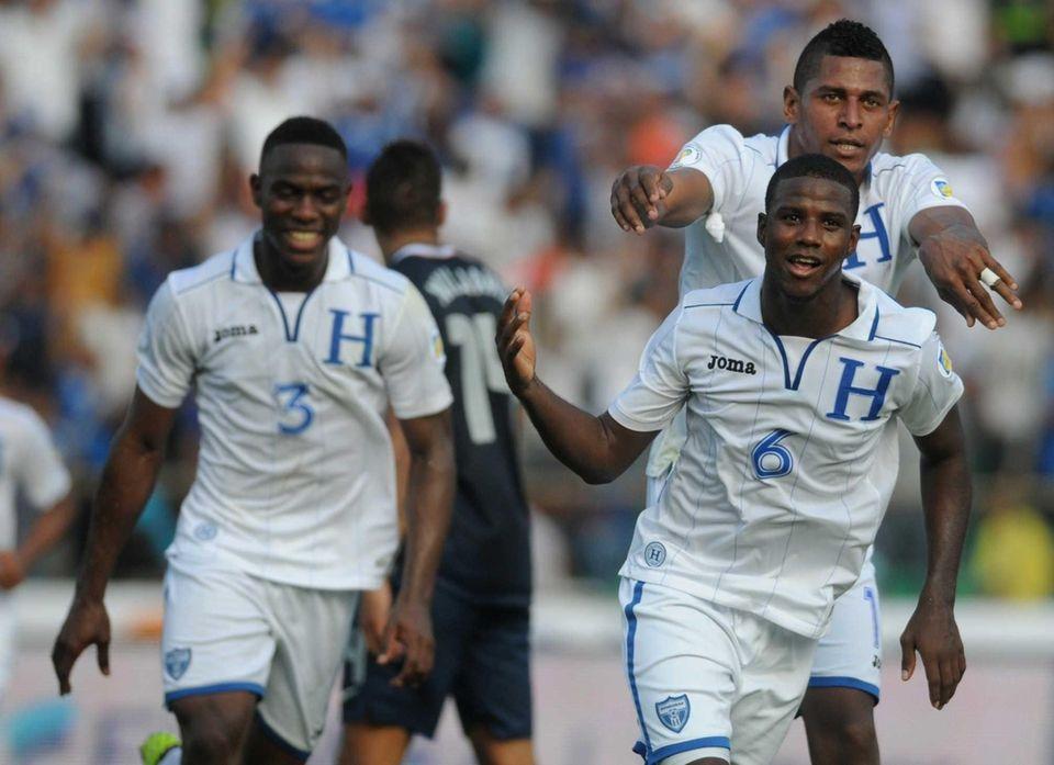 Honduras' Juan Carlos Garcia, front, celebrates followed by