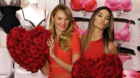 Victoria's Secret supermodels Candice Swanepoel, left, and Lily