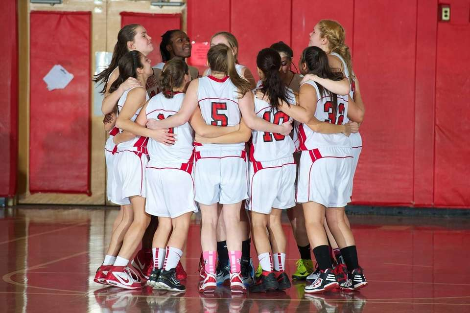 Floral Park huddles as a team before their