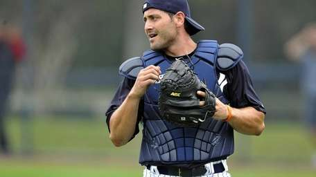 Francisco Cervelli looks on during spring training at