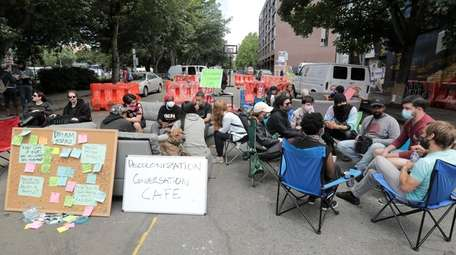 """People participate in the """"Decolonization Conversation Cafe"""" on"""