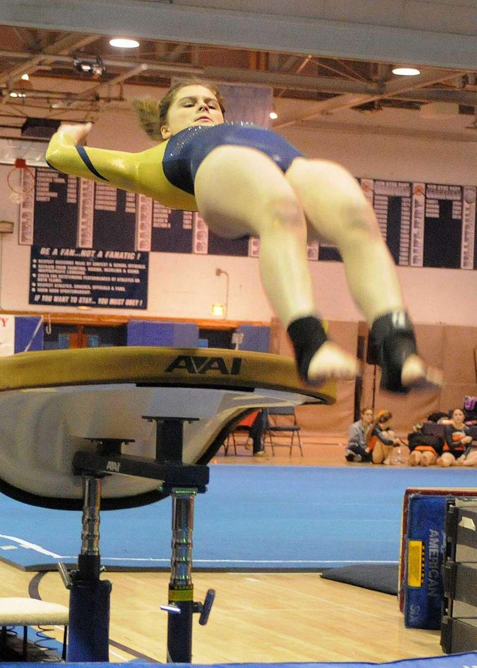 Kayla Castellano of Bethpage soars through the air