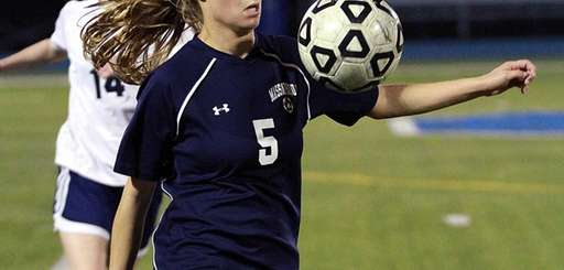 Massapequa's Rosie DiMartino controls the ball during game