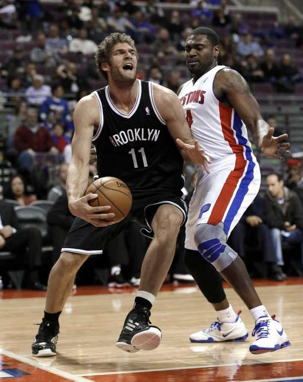 Nets center Brook Lopez drives on Detroit Pistons