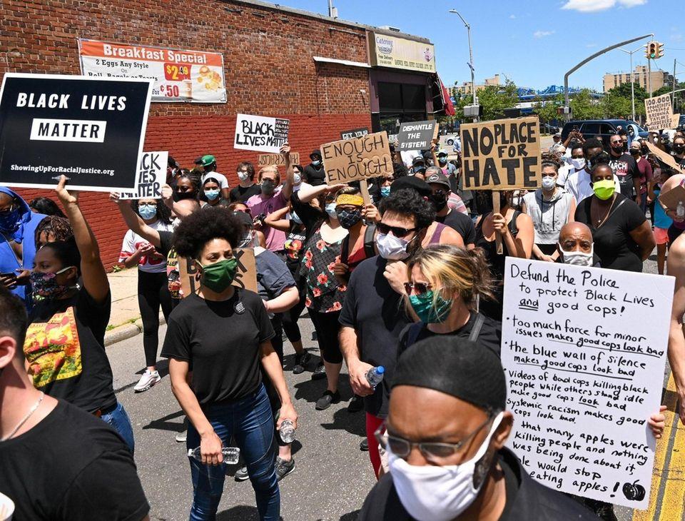 Protesters head towards Main Street in Hempstead as