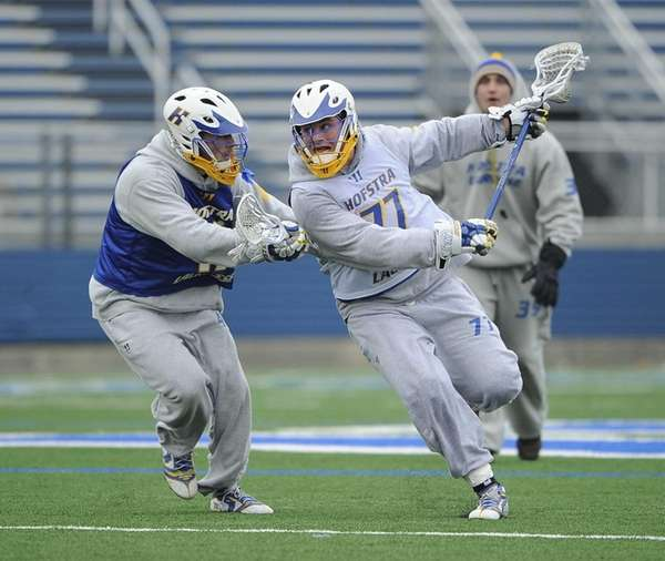 Hofstra University midfielder Adrian Sorichetti attempts to drive