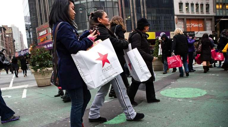 Post-Christmas shoppers flood Herald Square. The spending continued