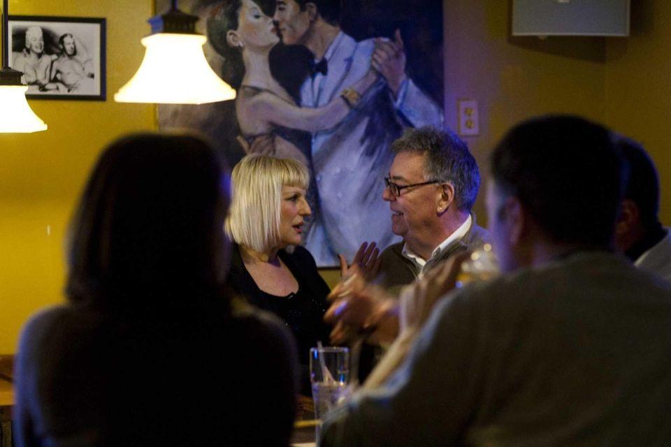 Customers chat at the bar at Five.Five 2
