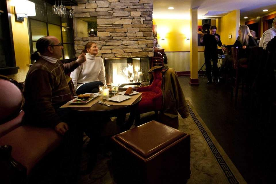 Five.Five 2 features a bar with a fireplace