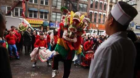A traditional dance troupe moves through Chinatown celebrating