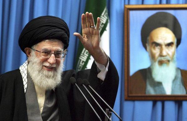 Iranian supreme leader Ayatollah Ali Khamenei waves to
