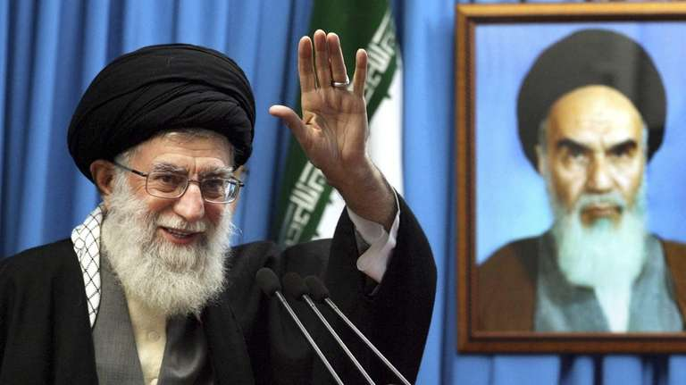 Iranian supreme leader Ayatollah Ali Khamenei waves to