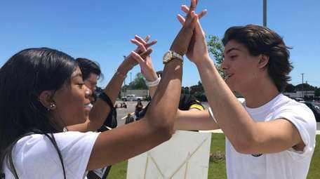 Michael Haggerty, 17, links hands with best friend