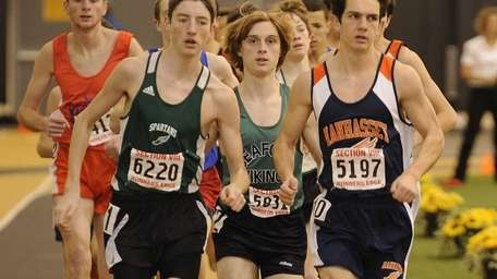 Manhasset's Stephen Bourguet, right, leads the field in