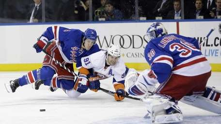 New York Rangers' Michael Del Zotto, left, becomes