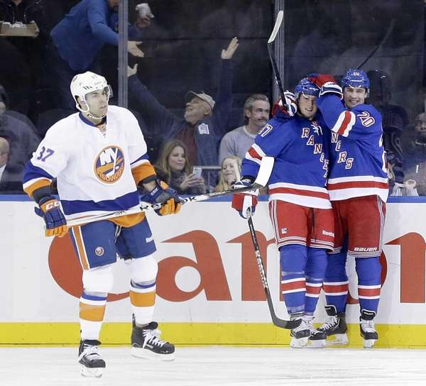 Rangers' Chris Kreider, right, celebrates after teammate J.T.