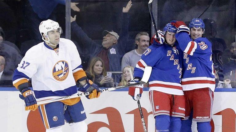 Rangers' Chris Kreider, right, celebrates after teammate J.T.