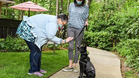 Judy Tarasek, of Positively Pet Partners, left, helps