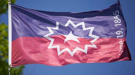 The Juneteenth flag flies in Omaha, Neb., on