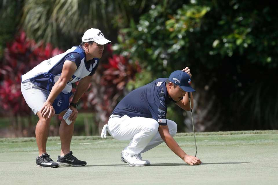 Kyoung-Hoon Lee of South Korea, lines up a